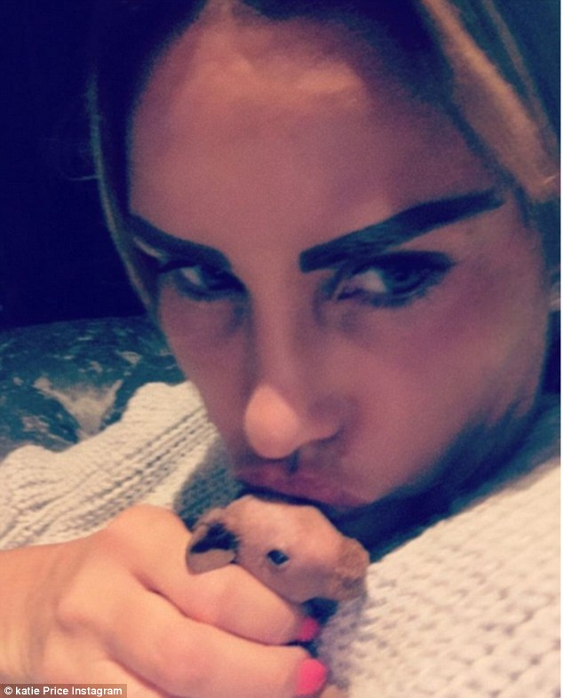 Katie Price Shows Off New Eyebrows As She Poses With Newborn Skinny Pig