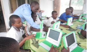 primary school students with laptops