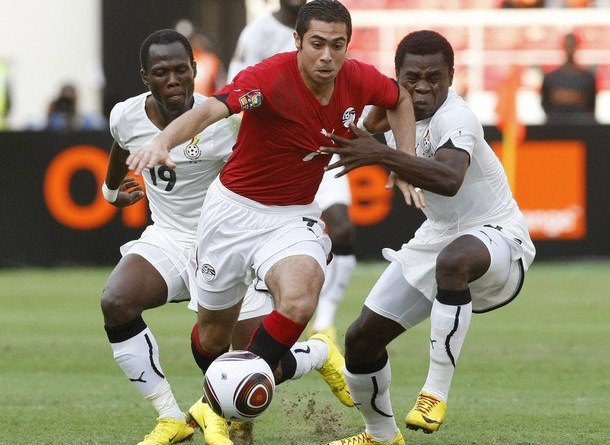 Egypt's Ahmed Fathi is challenged by Ghana's Emmanuel Agyemang-Badu and Opoku Agyemang during their African Nations Cup final soccer match in Luanda