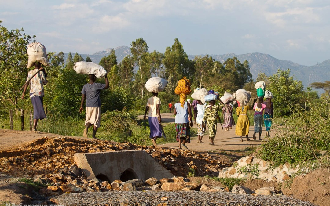 Photo: Women carrying sacks on their heads after market, Kisumu, Kenya.