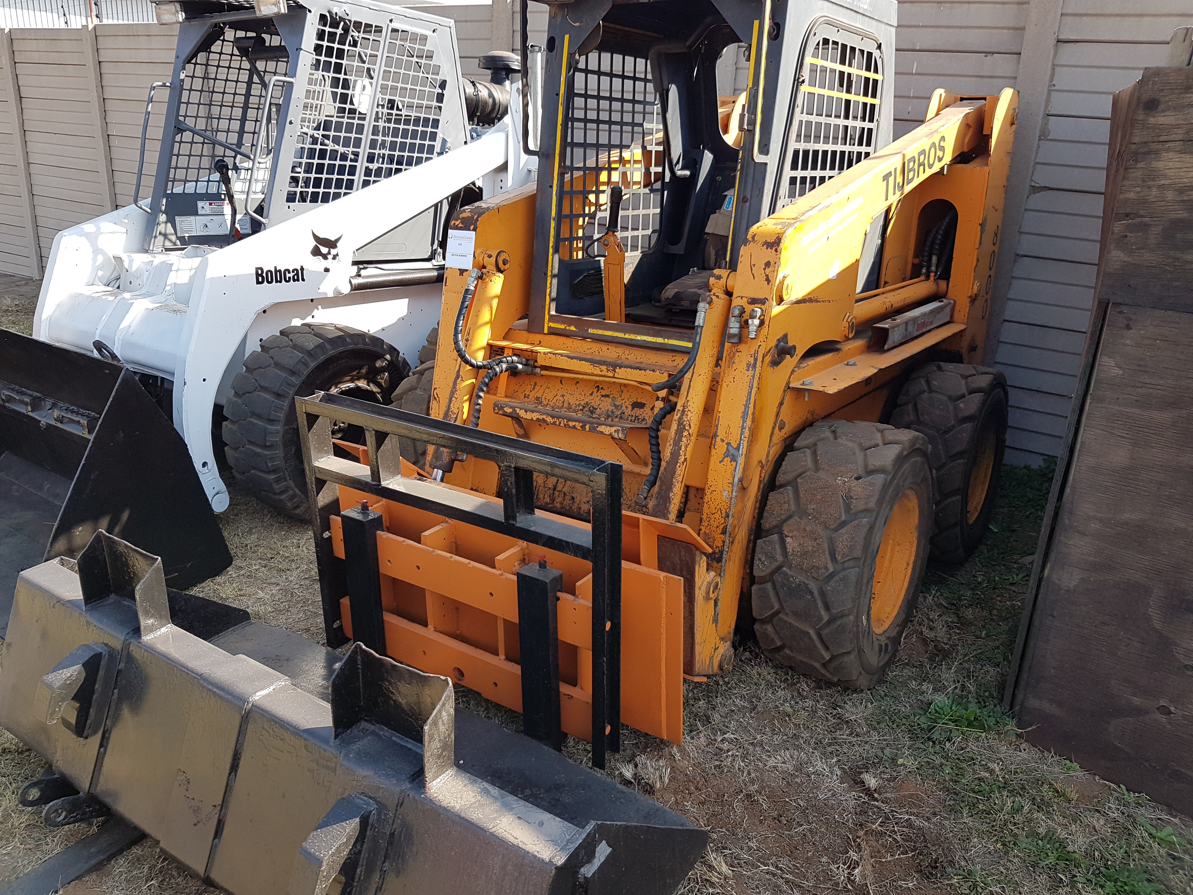 T.J BROS  SKIDSTEER LOADER WITH ATTACHMENTS