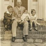 1934 (left) with father and siblings