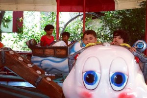 Piglet and friend on the caterpillar ride