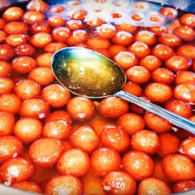Gulab jamuns in their sugar syrup