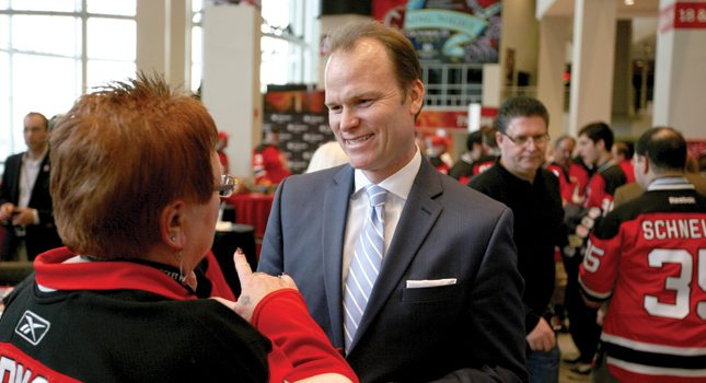 Hugh Weber, president of Devils Arena Entertainment, talks with a Devils' fan at the Prudential Center, Newark.