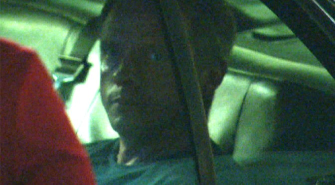 Micheal Bryant in police car after arrest