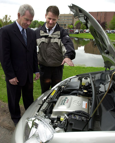 Minister Chester Gillan looks at the new Toyota Prius with Randy Cameron on June 1, 2001