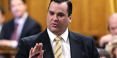Honorable Minister James Moore, does he own a smartphone?