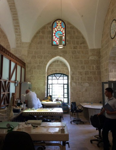 image of document restorers at work, al Haram al-Sharif Jerusalem