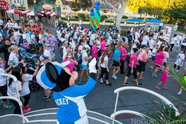 mickey-mouse-waves-at-choc-walk-participants-as-they-walk-down-main-street-u-s-a