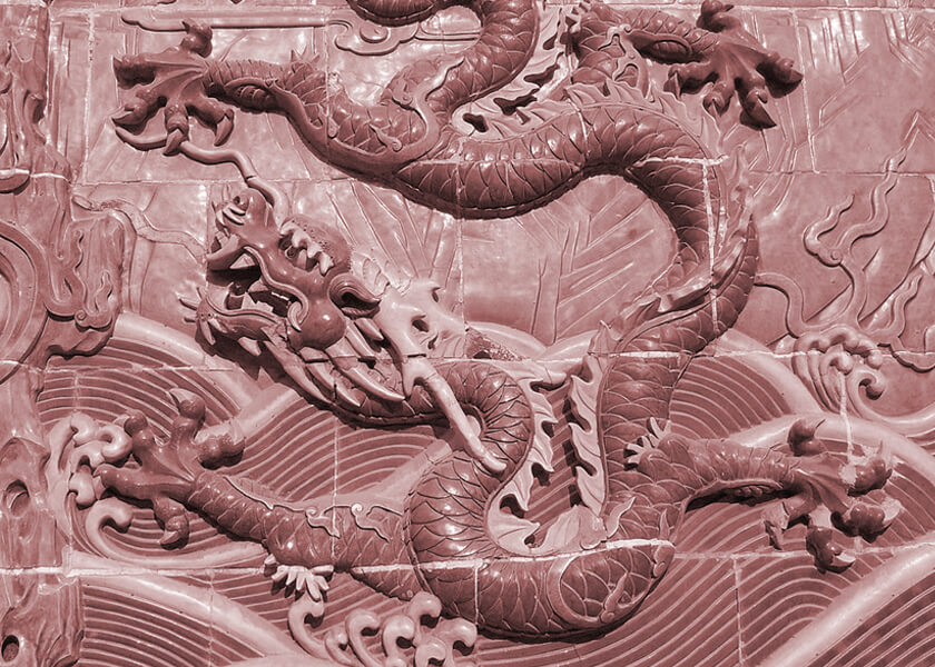 Five-clawed dragon on a Nine-Dragon Wall in Beihai Park, Beijing, China (Former Imperial Chinese palace and garden)