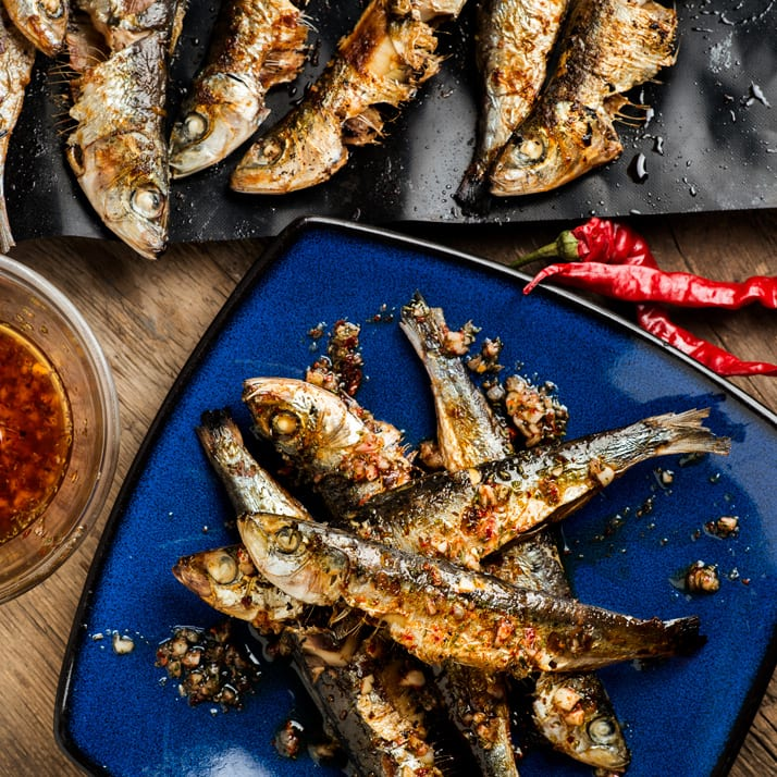 grilled-sardines-dress-with-olive-oil-hot-peppers-garlic-and-oregano