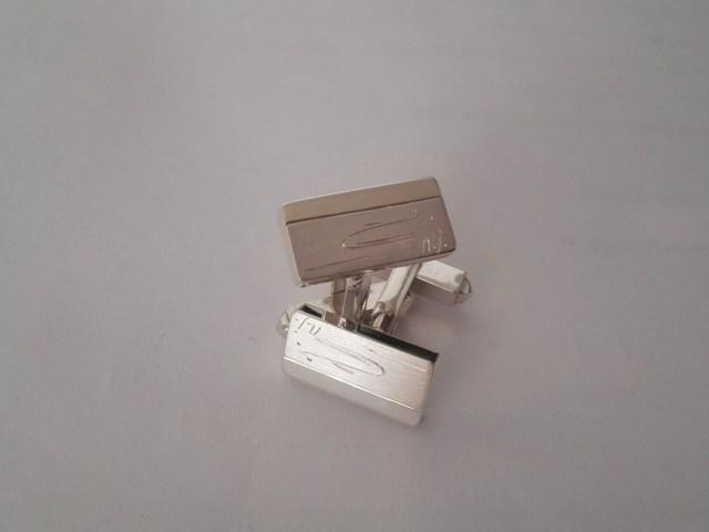 Zilveren manchetknopen met handgravure