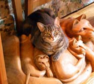Nora on the cat sculpture.
