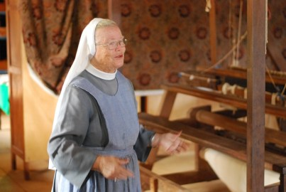Abbess Hanna Ludmilla Wolf explains about the crafts workshop which make table cloths, carpets and wood items, including string instruments.