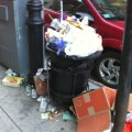 Overflowing trash barrel near the corner of Hanover & Fleet Streets. (Photo by M. Conti)