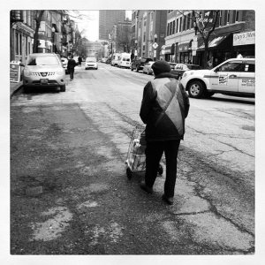 Woman Pushing Cart on Hanover by Paula Noukas Taylor - March 2012