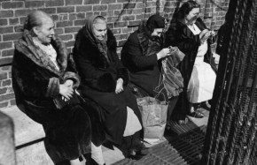 1939 - Women sat, sewed, and visited near Hanover Street in the North End. Boston Globe File