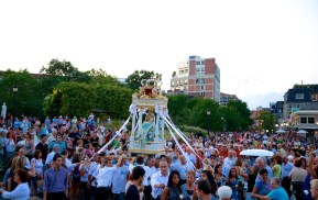 Devotees of the Madonna del Soccorso gather at Christopher Columbus Park for the Blessing of the Fishing Waters.