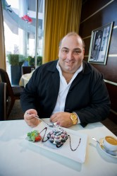 Nick Varano, owner of Strega restaurant, with the famous Chocolate Berry Tart created by Pastry Chef Salvatore Firicano for Boston Bakes for Breast Cancer (Photo by Sam Ogden)
