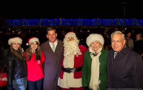 Mayor Thomas M. Menino (right) and Mayor-Elect Marty Walsh (center join Friends President Joanne Hayes-Rines along with Santa and his elves at the trellis lighting