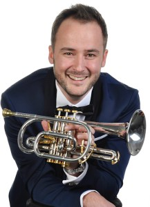 Harmen with cornet smiling