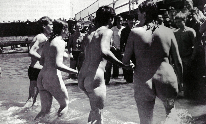"On 25 August 1965, Jefferson Poland, wearing a flower in his hair and joined by two twenty-one year old women and a number of clothed picketers, carried out his ""nude wade-in"" at San Francisco's Aquatic Park. Lee Baxandall, World Guide to Nude Beaches and Recreation (New York: Stonehill Publishing Company, 1980), 40."