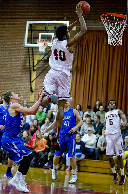 Malcolm Delpeche '17 dunks against Colby (Courtesy of Bates Athletics)