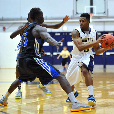 Jaquann Starks '15 is comfortable with the ball in his hands, but Trinity's O runs smoother with Starks at the two-guard. (Courtesy of Hartford Courant/Peter Casolino).