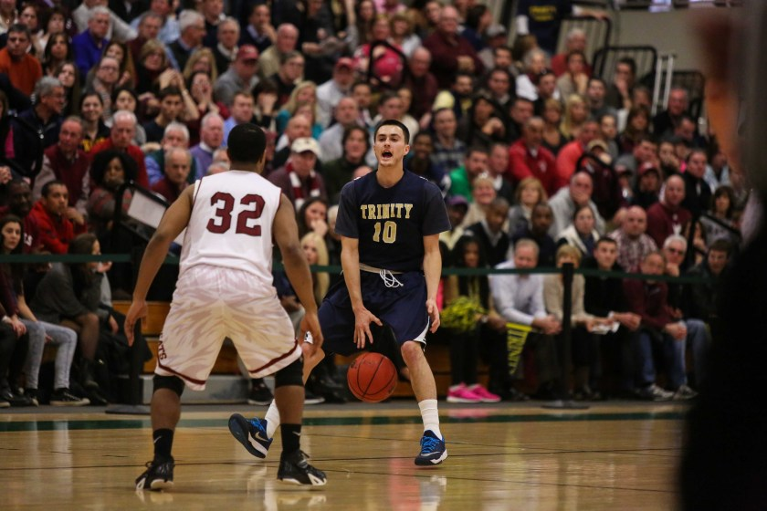 Andrew Hurd '16 with the ball in the Sweet Sixteen Game vs. Bates. (Courtesy of Trinity Athletics)