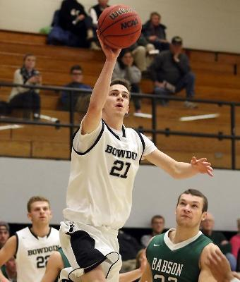 Lucas Hausman '16 was an easy choice for the NbN NESCAC Player of the Year, and teammate Jack Simonds '19, seen here mesmerized by a Hausman drive, was a nearly as easy pick for Rookie of the Year. (Courtesy of Bowdoin Athletics)