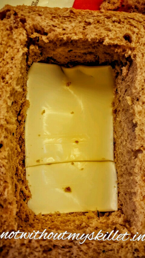 The cheese at the bottom will also prevent any spillages into the base of the bread