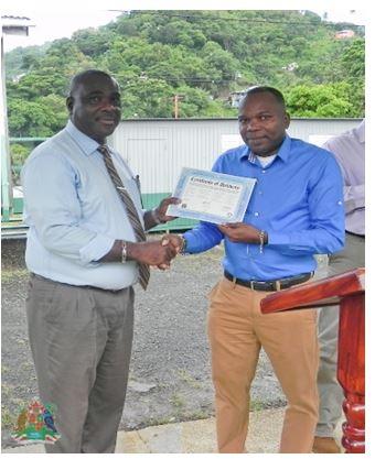 Principal Belfon receiving donation
