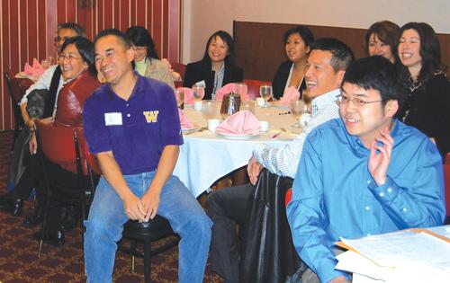 Community members gathered at Sun Ya Restaurant to watch the friendly debate between Mallahan and McGinn (Photo by George Liu/NWAW)