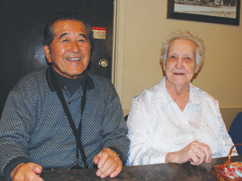 Bill Akiyoshi (left) catches up with former eighth grade classmate Arvy Toms.