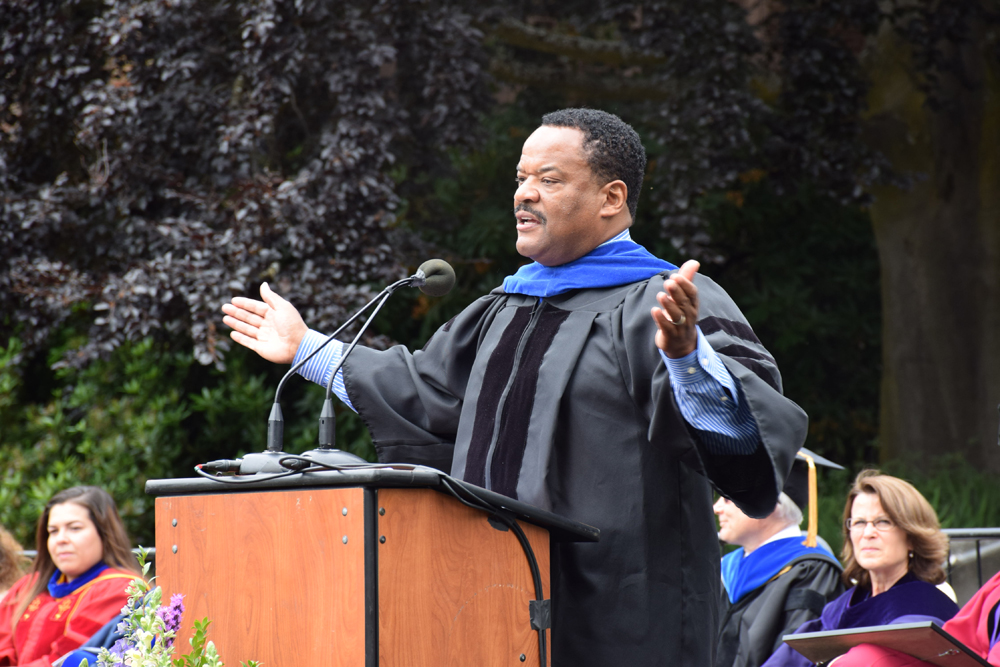 Eli Lilly's vice president, Nate Miles, speaks at the UW graduation on June  9 at the Quad. (Photo by George Liu/NWAW)