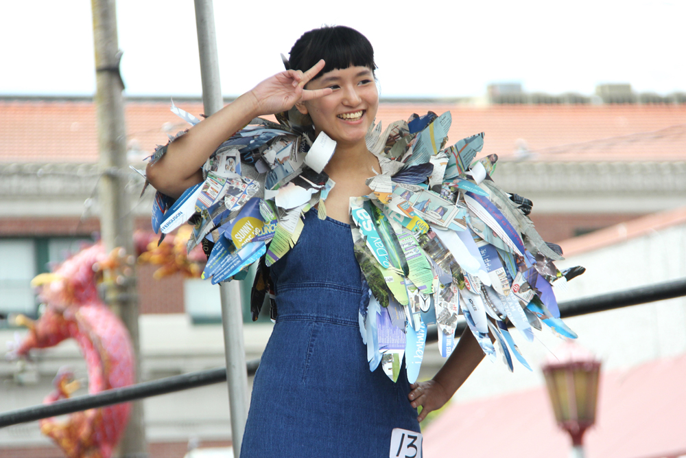 """Designed by Heather Chan. The cape was inspired by a kingfisher-feather cape from a Chinese fairy tale. The """"feathers"""" are all from Seattle publications including NWAW. (Photo by Eugene Tagawa)"""