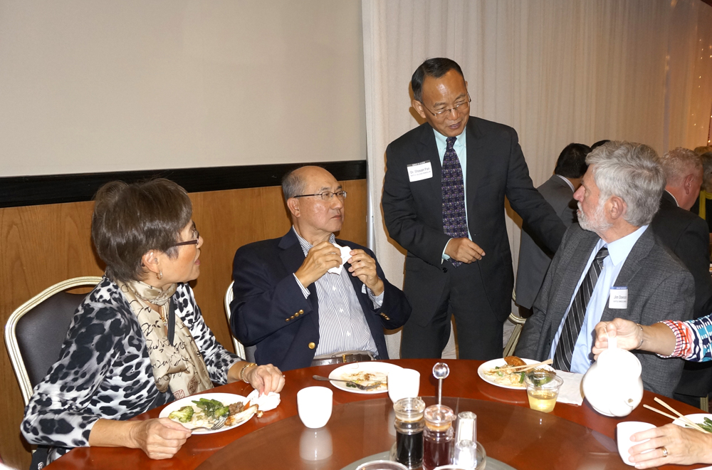 From left: Former Seattle Colleges chancellor Peter Ku and wife Sophia Ku, Jim Dawson