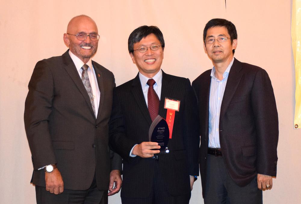 From left: Award presenter and event sponsor representative Charles Herrmann (Herrmann Scholbe), honoree Harry Shum (Microsoft), and honoree introducer and sponsor representative Ming Zhang (MZA Architecture).