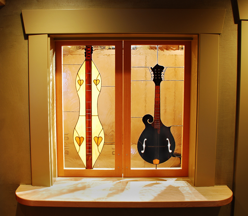 Custom made stained glass windows for a music room.