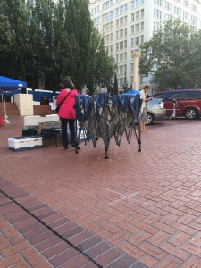 Setting up a tent in Pioneer Courthouse Square.