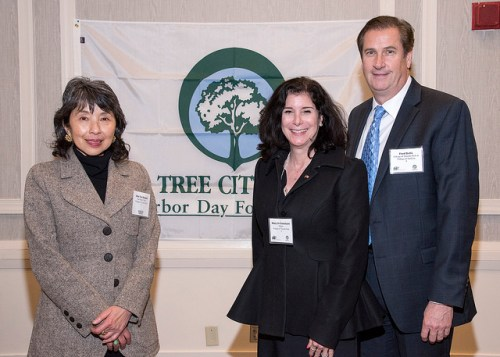 Chiu Yin Hempel, Tree Board Chair of Tuxedo Park, Mayor Mary Jo Guinchard, and Fred Rella, Village of Tuxedo Park, celebrate their second year as a Tree City USA after Chiu Yin and Mayor Guinchard presented on the Village's urban forestry related activities.