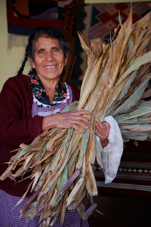 Magdalena with corn husks to prepare tamales