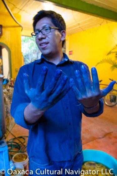 Eric Chavez Santiago at the indigo dye pot