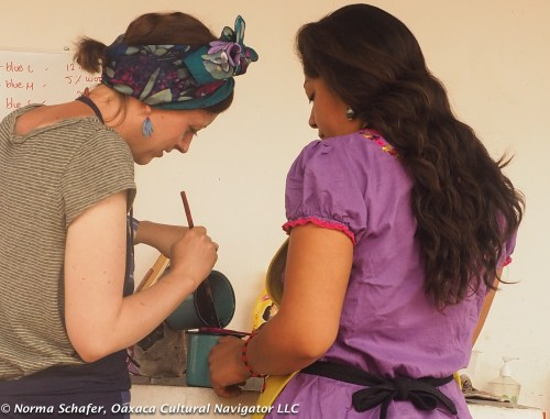 Rhiannon and Elsa strain the cochineal concentrate for the dye pot