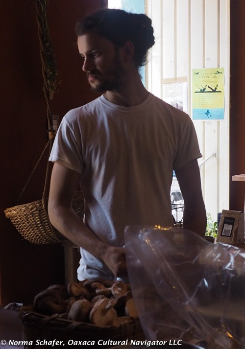 Daniel weighs wild mushrooms that grower has just brought in