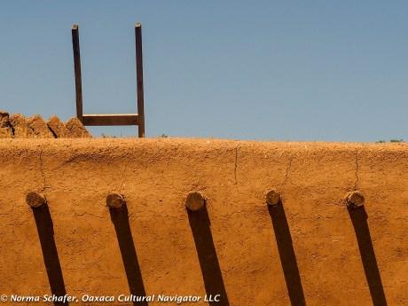 Three foot adobe walls, wood beams called vegas to hold up cedar ceilings