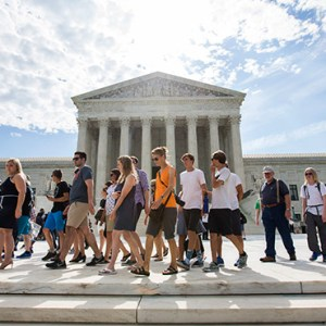 VISITORS WALK PAST THE U.S. SUPREME COURT BUILDING IN WASHINGTON JUNE 15. THE HIGH COURT ANNOUNCED IN NOVEMBER IT WILL HEAR APPEALS FROM RELIGIOUS GROUPS IN THEIR LEGAL CHALLENGE OF THE OBAMA ADMINISTRATION'S CONTRACEPTIVE MANDATE. / PHOTO: (CNS PHOTO/JIM LO SCALZO, EPA)