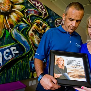 ERIK AND STACEY REES HOLD A PHOTO OF THEIR DAUGHTER JESSIE, WHO DIED OF CANCER IN 2012. THE JESSIE REES FOUNDATION WAS STARTED TO FULFILL THEIR DAUGHTER'S WISH TO ENCOURAGE EVERY CHILD FIGHTING CANCER TO NEVER GIVE UP. / PHOTO: COURTESY OC REGISTER