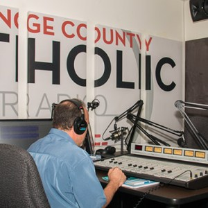 JIM GOVERNALE, A PRODUCER AND HOST FOR ORANGE COUNTY CATHOLIC RADIO, IN THE RADIO STUDIO IN THE TOWER OF HOPE AT THE DIOCESE OF ORANGE.